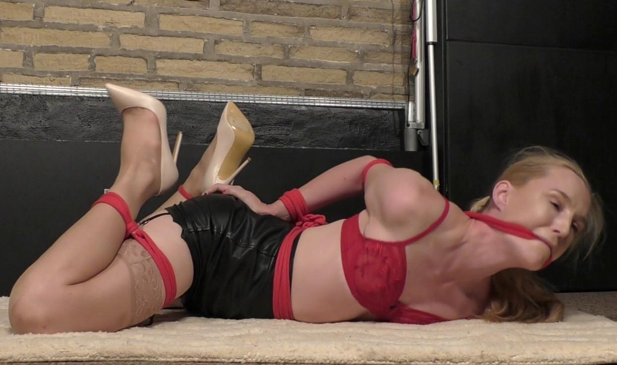 Rope gagged, frog tied and hogtied of Ariel Anderssen with thick red rop