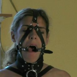 Leather Bondage - Juliette is ring gagged and anal plugged