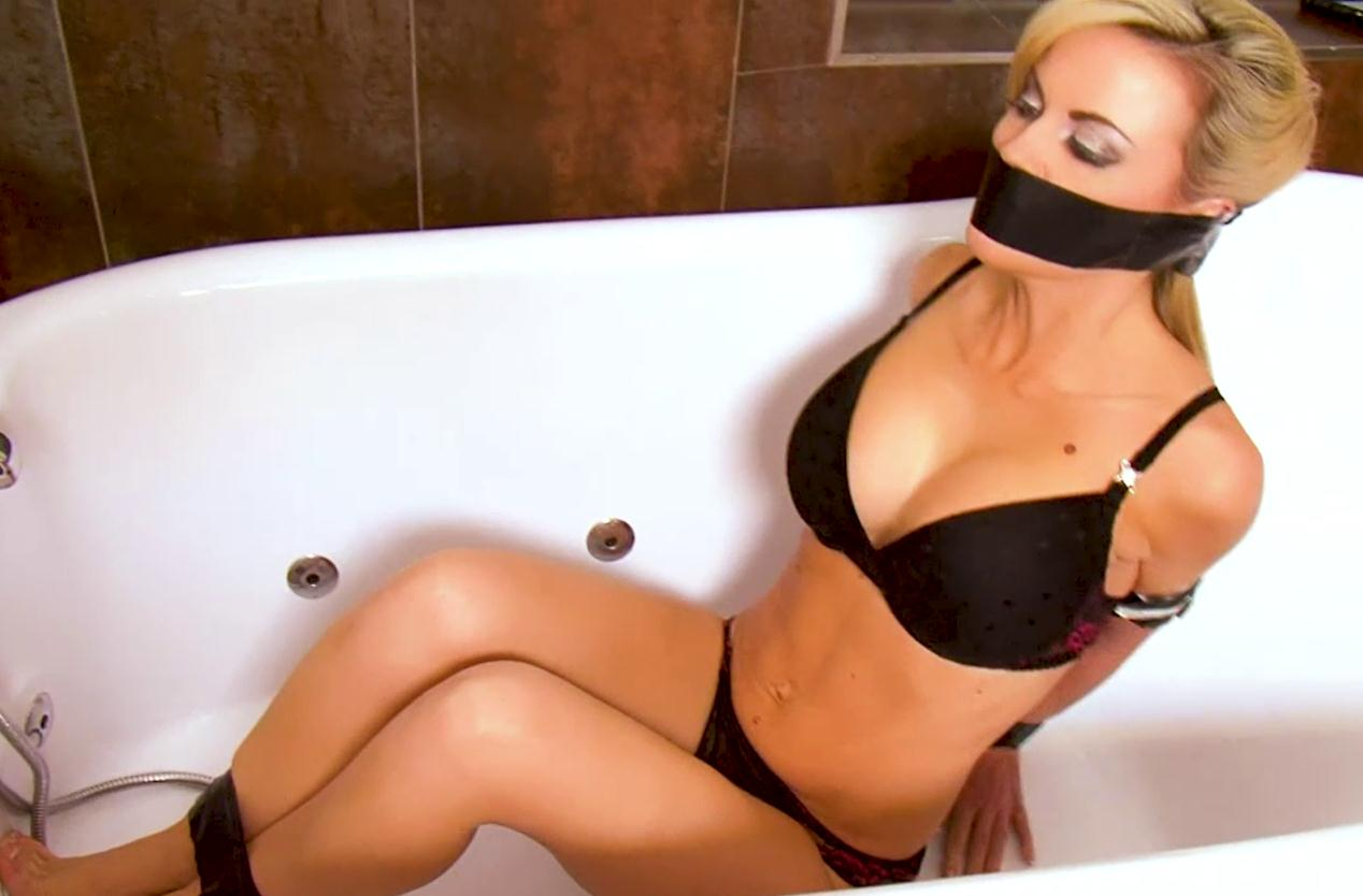 Tape gag for Jasmine Sinclair Bound in the Bath!