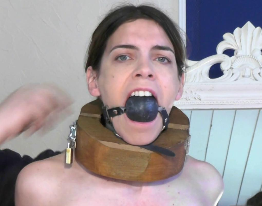 Slave gets used to her bondage equipment, leather bondage and neck stock