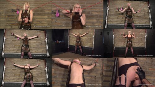 Self Bondage of Tracey Lain in a Latex Dress  and fishnet stockings is tied spread eagle