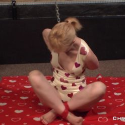 Selfbondage by red rope and cuffs of Anita De Bauch in little latex outfit