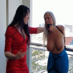 Socialite Sandra Silvers gagged with ropes black ball gag - Exposed and taunted in balcony torment by bad girl Caroline Pierce