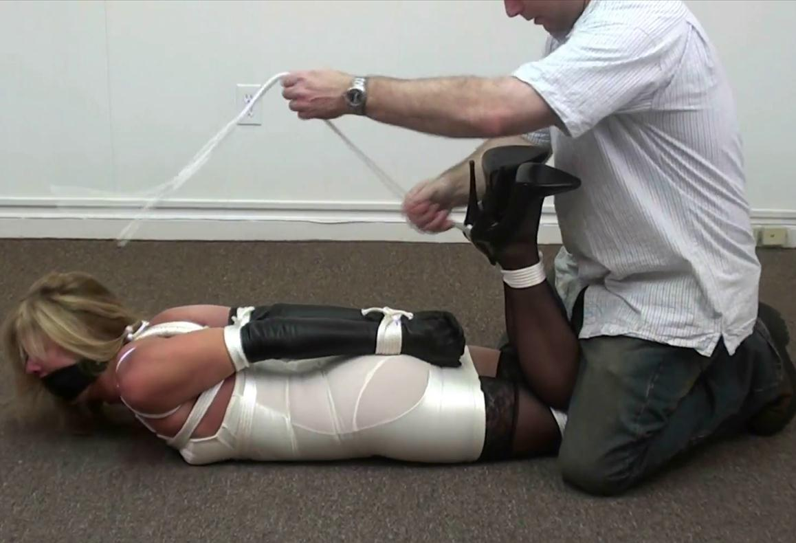 Retro style - Gagged Dakkota is tied in a sitting strappado with my black leather strap gag - Rope bondage