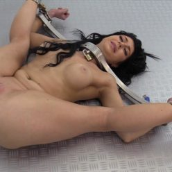 Stacked slave girl Little Lanta in the wall with metal cuffs- Metal Bondage - Gymnast