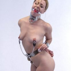Metal Bondage - Lucy Lauren - locked in a tight ver heavy belt, heavy clamps, heavy steel collar, and steel wrist cuffs