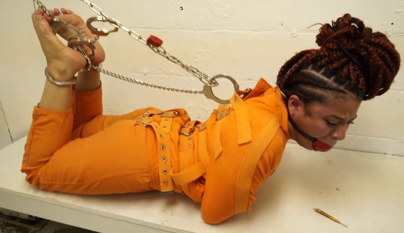 rison bondage - Purple Jade arrested for vandalizing her sugar daddy's car - She is strictly bonded with a leather blindfold into an orange jumpsuit, leg irons and waist chain - Uniform bondage