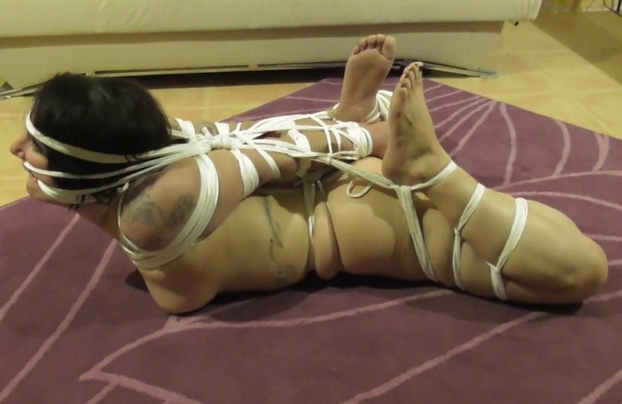 Extreme bondage - Bound girl with super tight ropes by extreme bondage specialist Sasori - TattooeDMomo in her first ever super tight Hogtie