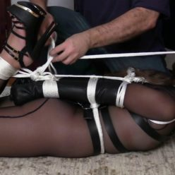 Rope bondage - Immobilized Rachel Adams submits to rope and leather wears stunning, sheer catsuit. She is tied with a fantastic leather bodyharness - Leather bondage