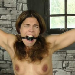 Ball gag for Juliette to spread eagle tied - Juliette Gagged For Whipping