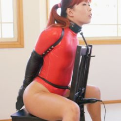 Restricted senses - Mina chair bound with rope, laced into a tight gwendoline armbinder and collared. She in red thong bodysuit - Rope bondage