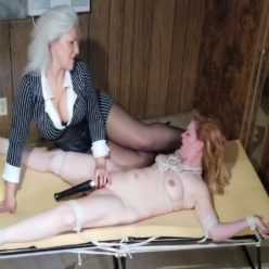 Ball gagged and spread eagled milf Sandra Silvers seeks repayment from naked bound blond Lisa Harlotte