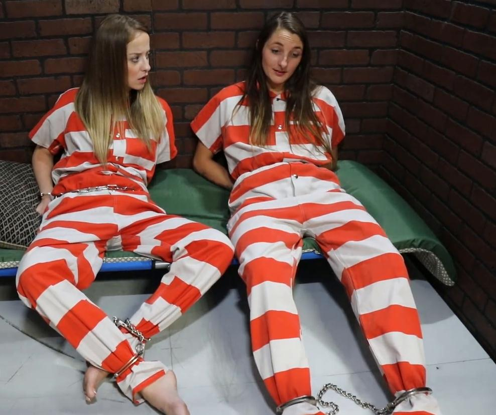 Prisonteens Jade and Nathalie put heavy their waist chains are with handcuffs and shackles on. - Red Light Runner Part 3