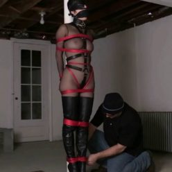 In the basement dungeon HD - Blindfolded Masha is roped up with shiny red nylon rope a black leather blindfold and wears my black leather strap gag - She in super sexy outfit and thigh high boots - Fetish delight