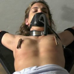 Tied is Juliette on a x-frame - Spread Eagle Tie - Heavy gag for her big ballgag and breathergag
