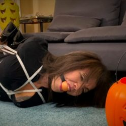 Nyxon and milf GiGi is hogtied and bound tightly with orange ballgag… Halloween Scrooge Gets The Ultimate Trick