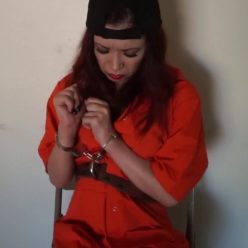 Cuffs bondage - Arrested Lily is handcuffed and shackled by the female officer in jumpsuit - Bondage play in prison
