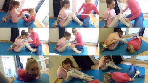 Kim and Larissa: bondage workout - Helpless Kim is hogtied and balggagged - Rope bondage