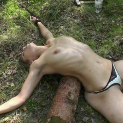 Spreaded In The Forest - Tied Juliette is spread eagle tie with ropes