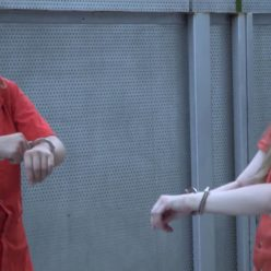 Prison Babes - Prisoners Paige and Corrina play with metal hand cuffs in the yard - Spend time in the yard