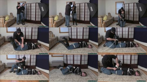 Complete control - Sexy bondage Goddess Rachel Adams is tightly bound and gagged with white ropes, a black leather strap gag.  In jeans, black leather gloves and knee boots