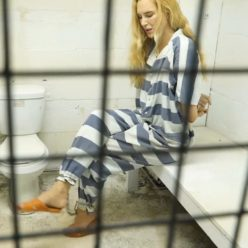 Cuffed Ariel Anderssen in jumpsuit with metal cuffs and legs iron - First arrested at hotel Extra - Metal bondage