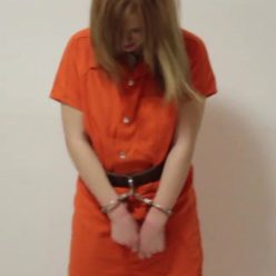 Metal bondage - Tani goes to jail for drug possession - Cute girl is cuffed with hand cuffs and leg iron in jumpsuit - Metal cuffs and leg iron