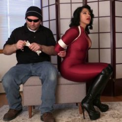 Bound Enchantress Sahrye with tight white rope in her red spandex catsuit and OTK Boots! Luscious body keeping under control - Rope bondage
