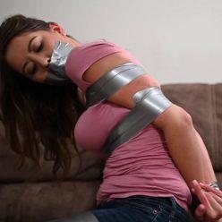 Captive Chrissy Marie is tape bound - Struggle vigorously! - Tape bondage!