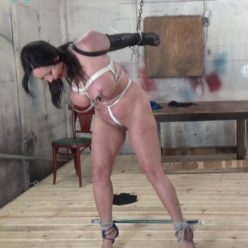Breast bondage - Christina Carter strung up and suffering with nipple clamps with a chain - Female bondage