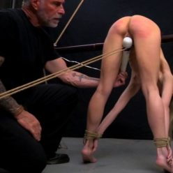 Rope bondage - Chrissy Marie is bound over bamboo and suspended - Take punishment!