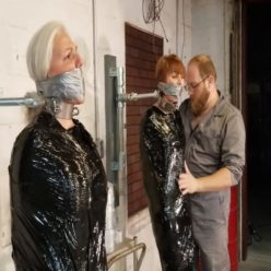 Sandra SIlvers and Vivienne Velvet are bound with black plastic pallet wrap, then duct tape with cold steel collars