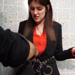 Michele James is arrested with handcuffs and leg shackles at her office part 2 of 2 - Metal bondage