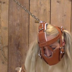 Sexy Liz Rainbow is high security patient in medical muzzle and tigtly straitjacket