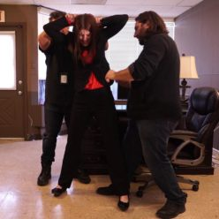 Michele James is arrested with handcuffs and leg shackles at her office part 1 of 2 - Metal bondage