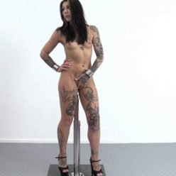 Metal bondage - Tattooed Nayomi Sharp is impaled in steel wrist cuffs - One Bar Prison