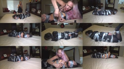 Blonde captor Vicky Vixxx torments rich milf held for ransom - Taped up, zip tied and tape gagged on the bed - Female bondage