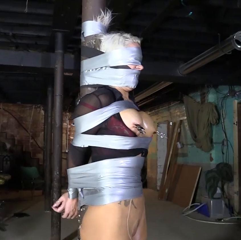 Tape bondage - Adara Jordin is fixinged to a post with tight tape - Things continue to get bad