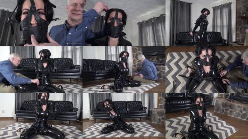 Leather bondage - Raven Eve is tightly cinched with leather straps in PVC catsuit. - Tightly frog tied