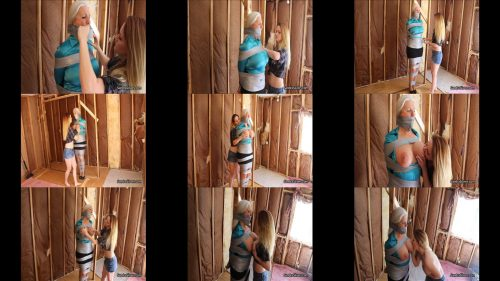 Tape bondage - Satin Secretary - Sandra Silvers is captured in duct tape at country gal Lisa's Remote Trailer - Lesbian bondage