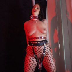 Showsomerestraint - Ruby Lulu is cuffed in place on the bondage with the rabbit harness - Rope bondage