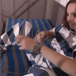 Metal bondage - Magda wears handcuffs and ankle cuffs in jail - A chic bondage combination