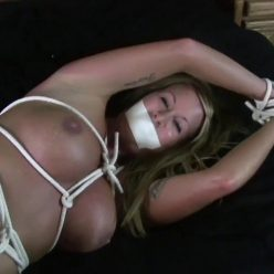 Rope bondage -Jamie Knotts is bound tighly with rope. She struggles against the tight crotch rope!