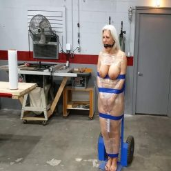Tape bondage - Sandra Silvers is massively ballgagged, mummified in the shop - Strict bondage - Orgasmic pleasure
