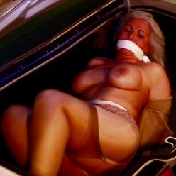 Rope bondage - Milf Sandra Silvers, P.I. is tied and gagged in the trunk! -Transported in Car Trunk