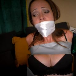 Rope bondage - Slyyy is ambushed and mouth stuffed, taped to a chair - She's taped tightly to a chair, stripped to her bra, blindfolded and gagged