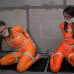 Ashley Lane and Chrissy Marie struggle to escape - Trapped In Imprisonment - The girls is tigtly roped and ballgagged and wrapped in microfoam tightly