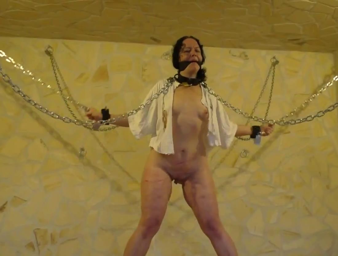 Minuit is chained up in heavy metal and bull whipped - Chain hogtie predicament Minuit - Metal bondage