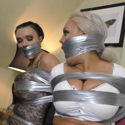 Borderlandbound - Kaitlin and Leah in: One Heavy Night of Buxom Skin-Tight Tape Terror - Full Movie - Tape Bondage