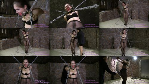 Metal Bondage - Rachel Adams is in heavy metal bondage with a big collar and nipple clamps - In the dungeon part 1 of 3